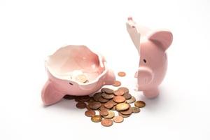 Pink piggy bank broken with money